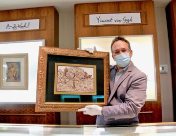Jeweler Bob Strehlau holds an ink drawing by Vincent Van Gogh