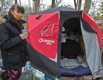 Dottie Spillane has been living near a creek in Norristown with her husband since the summer. She and her husband use a propane heater to heat their insulated tent as temperatures drop. (Kimberly Paynter/WHYY)