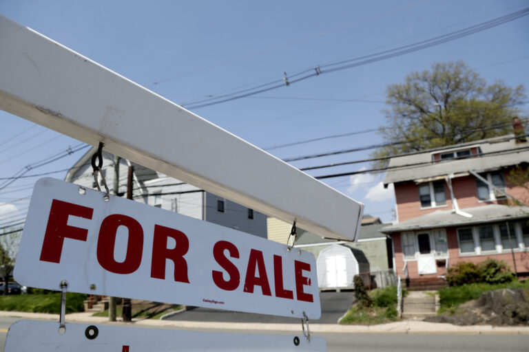 A for sale sign hangs from a post outside of a vacant business building, Thursday, May 3, 2018, in Belleville, N.J. (AP Photo/Julio Cortez)
