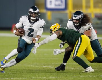 Philadelphia Eagles' Jalen Hurts runs during the second half of an NFL football game against the Green Bay Packers Sunday, Dec. 6, 2020, in Green Bay, Wis. The Packers won 30-16. (AP Photo/Matt Ludtke)