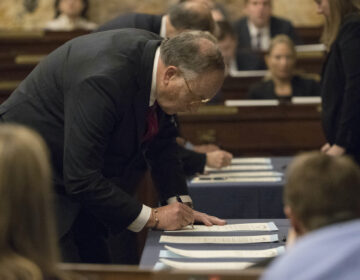 In this file photo from Dec. 19, 2016, elector Robert Gleason certifies the results during Pennsylvania's 58th Electoral College at the state Capitol in Harrisburg, Pa., Monday, Dec. 19, 2016. (AP Photo/Matt Rourke)
