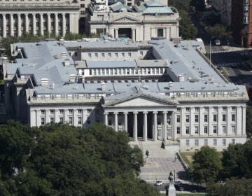 The U.S. Treasury Department building viewed from the Washington Monument, Wednesday, Sept. 18, 2019, in Washington. (AP Photo/Patrick Semansky)
