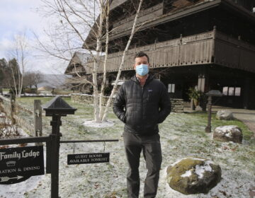 Bob Schwartz, the director of marketing of the Trapp Family Lodge poses outside the lodge on Tuesday, Dec. 15, 2020 in Stowe, Vt. (AP Photo/Wilson Ring)