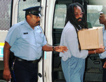 This July 25, 1995 file photo shows Mumia Abu-Jamal, convicted in the 1981 murder of Philadelphia police Officer Daniel Faulkner, in Philadelphia. (AP Photo/Nanine Hartzenbusch)
