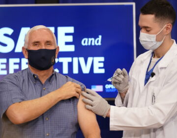 Vice President Mike Pence receives a Pfizer-BioNTech COVID-19 vaccine shot at the Eisenhower Executive Office Building on the White House complex, Friday, Dec. 18, 2020, in Washington. (AP Photo/Andrew Harnik)
