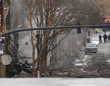Emergency personnel work at the scene of an explosion in downtown Nashville, Tenn., Friday, Dec. 25, 2020. Buildings shook in the immediate area and beyond after a loud boom was heard early Christmas morning. (AP Photo/Mark Humphrey)