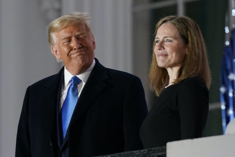 In this Monday, Oct. 26, 2020 file photo, President Donald Trump and Amy Coney Barrett stand on the Blue Room Balcony after Supreme Court Justice Clarence Thomas administered the Constitutional Oath to her on the South Lawn of the White House White House in Washington. (AP Photo/Patrick Semansky)