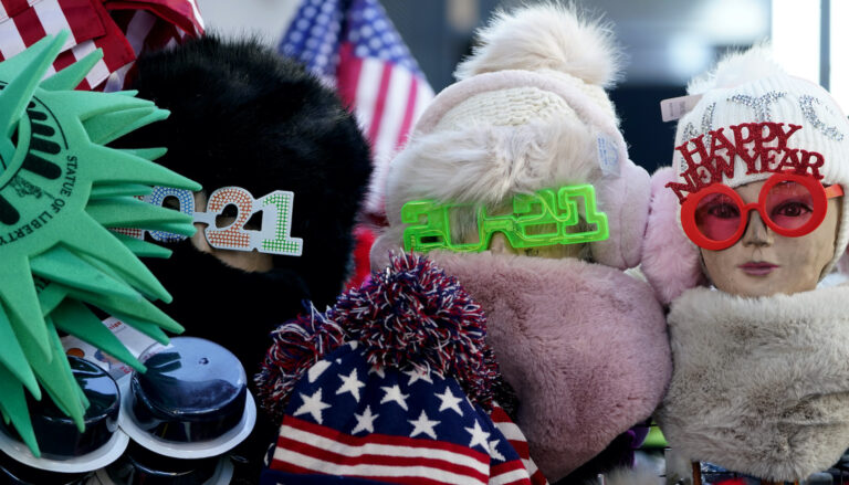 Only a few items celebrating the new year are displayed at the vendor's stall in Times Square, New York, Monday, Dec. 28, 2020. (AP Photo/Seth Wenig)