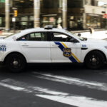 A police car drives in Philadelphia