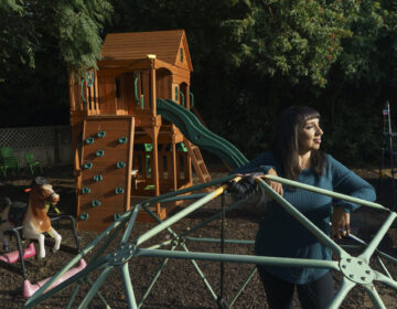Mary De La Rosa stands inside a geodesic play structure at her home back yard