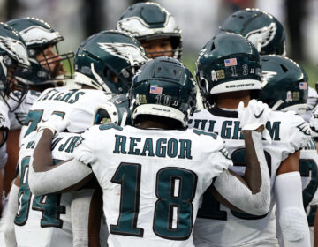 Philadelphia Eagles wide receiver Travis Fulgham (13) with the words 'Black Lives Matter' and Philadelphia Eagles wide receiver Jalen Reagor (18) with the name 'Breonna Taylor' seen on their helmets