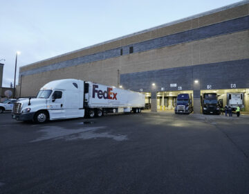 Boxes containing the Pfizer-BioNTech COVID-19 vaccine are prepared to be shipped at the Pfizer Global Supply Kalamazoo manufacturing plant in Portage