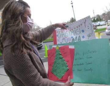 Kathleen Schallus sorts through holiday cards sent to Shore Medical Center