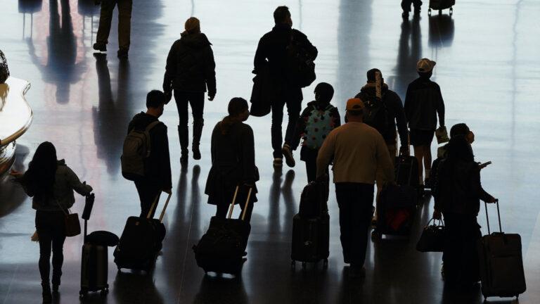 Travelers walk through the Salt Lake City International Airport