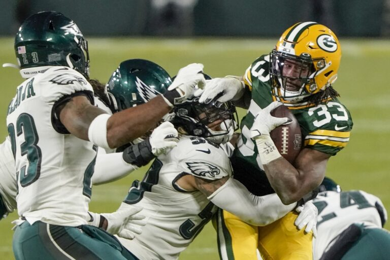 Green Bay Packers' Aaron Jones runs during the second half against the Philadelphia Eagles