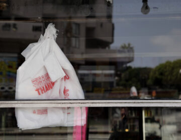 Plastic bags can be seen through the window of a restaurant