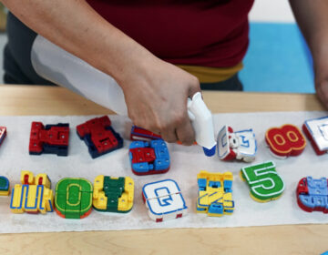 Pre-k teacher Monica Alvarez cleans and disinfects teaching tools as she prepares her classroom