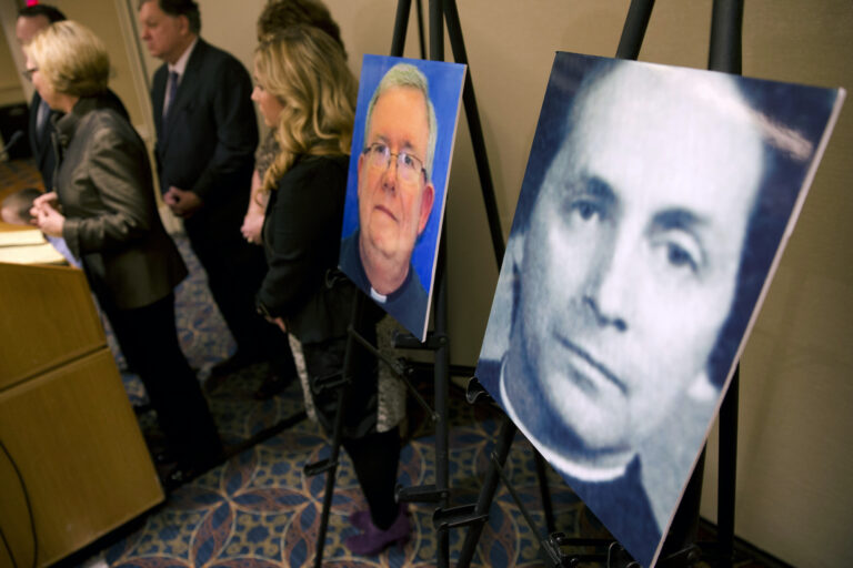 A photo of Rev. Robert Brennan, right, is displayed during a news conference in Philadelphia.