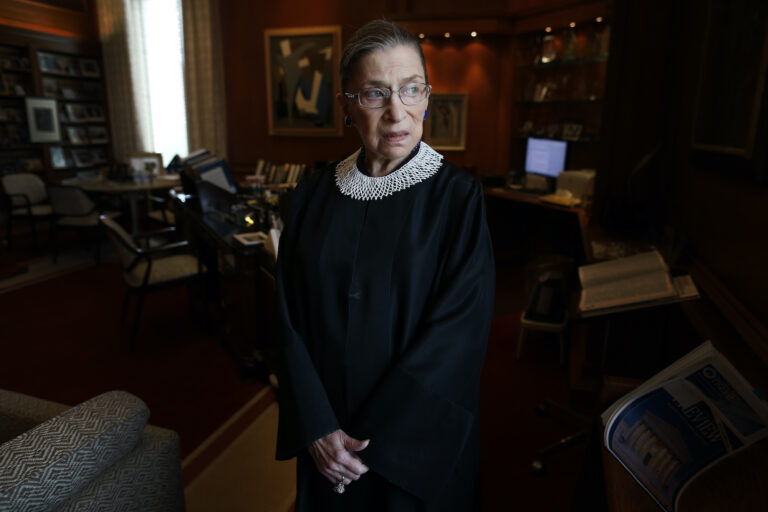 Ruth Bader Ginsburg poses for a photo in her chambers at the Supreme Court in Washington
