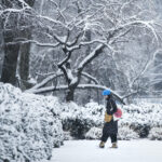 A woman walks in the snow at the Philadelphia Museum of Art in Philadelphia