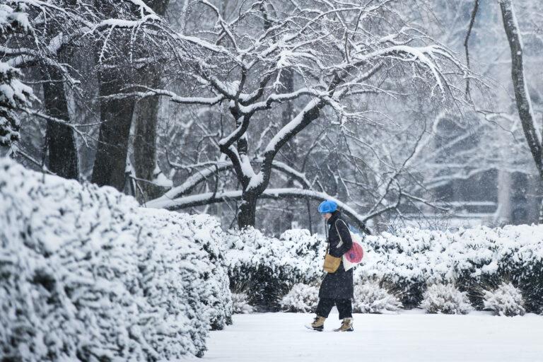 A woman walks in the snow at the Philadelphia Museum of Art in Philadelphia