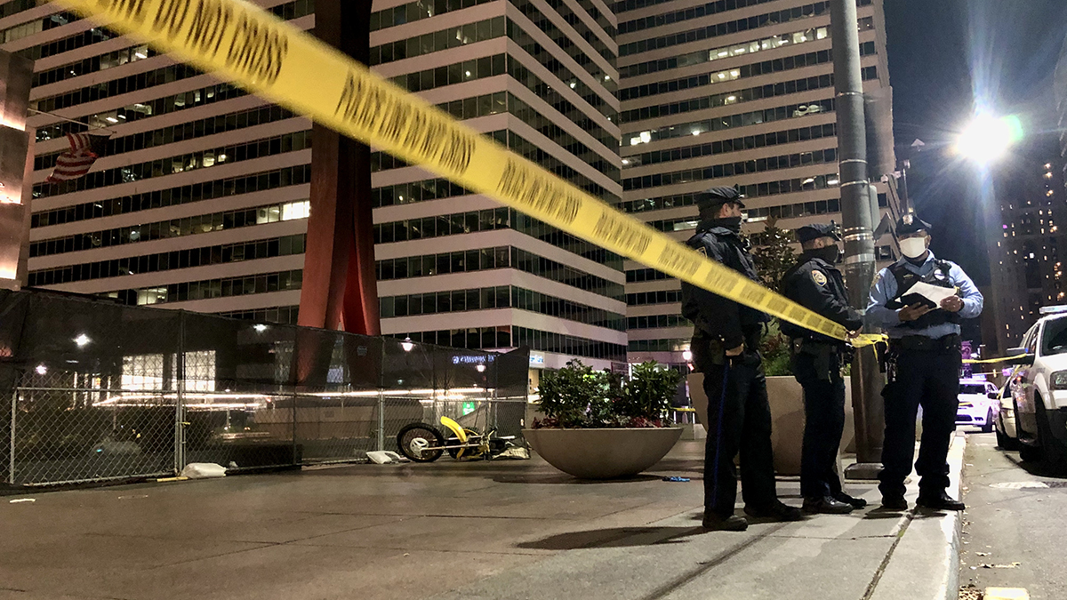 Police stand by the Clothespin Sculpture near City Hall, where a dirt bike rider was fatally shot on Nov. 16, 2020.