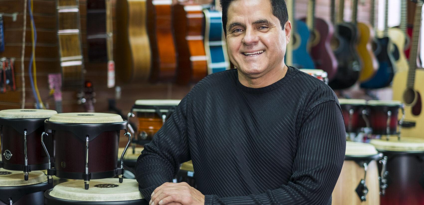Reinaldo Meléndez took over Centro Musical in 2014 after the former owner, Wilfredo Gonzalez, retired. | Reinaldo Meléndez se hizo cargo de Centro Musical en 2014 después de que el ex propietario, Wilfredo González, se retirara. (Photo by Bernardo Morillo for WHYY)