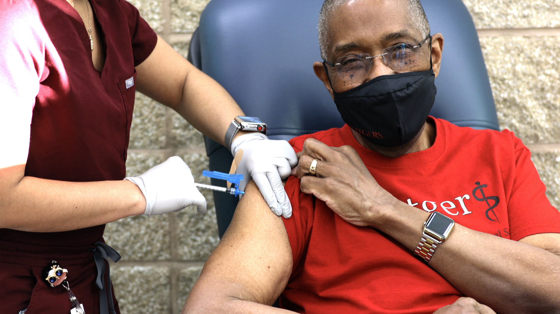 Robert Johnson, dean of Rutgers New Jersey Medical School, receives his first COVID-19 shot.
