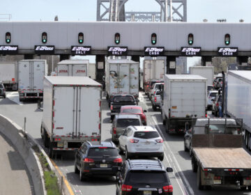 Cars and trucks line up at the entrance to the George Washington Bridge