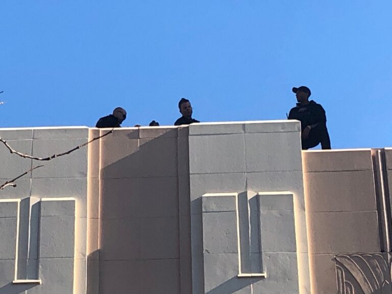 Counter-snipers take up posts atop The Queen theater and the neighboring Delaware History Museum in downtown Wilmington when Biden is there. (Cris Barrish/WHYY)