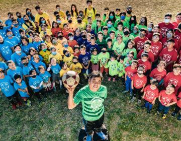 Luis Uribe with members of the Los Lobos soccer league. Uribe has been leading the league for over ten years. | Luis Uribe con miembros de la liga de fútbol Los Lobos. Uribe lleva más de diez años al frente de la liga. (Photo by Eugenio Salas for WHYY)