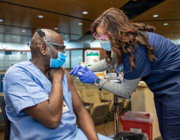 A Penn Medicine worker receives the Pfizer COVID-19 vaccine