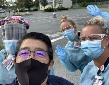 Dr. David Tam of Beebe Healthcare (center with black mask) says his staff is suffering from