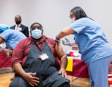 Temple Health System employees receive COVID-19 vaccinations on Dec. 16, 2020. (Photo by Daniel Burke)