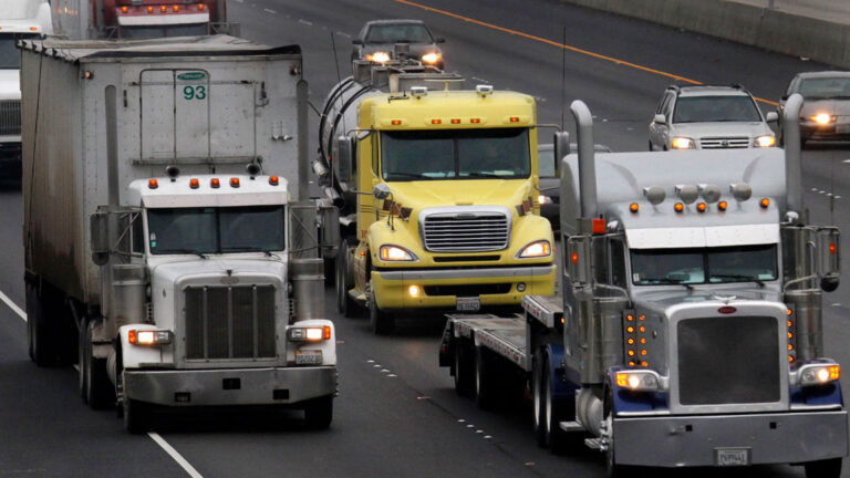 Trucks are pictured on a highway in this file photo.