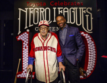 Negro Leagues baseball veteran Jim Robinson and ESPN/ABC correspondent Ryan Smith attend an event celebrating 100th anniversary of the league in New York in February. (Donald Traill/AP Photo)