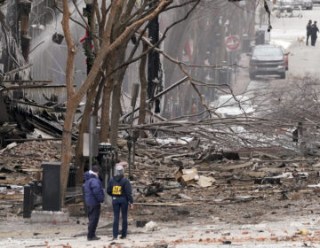 Emergency personnel work near the scene of an explosion in downtown Nashville