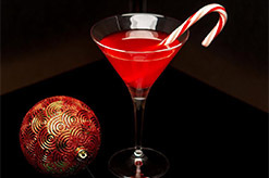 a cocktail with a candy cane in it