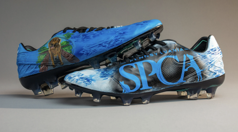 Customized cleats for Cam Johnston feature the PSPCA