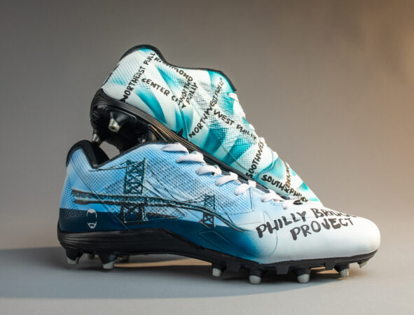 Customized cleats for Zach Ertz feature the Philly Bridge Project