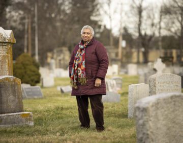 Joyce Mosley stands in Eden Cemetery