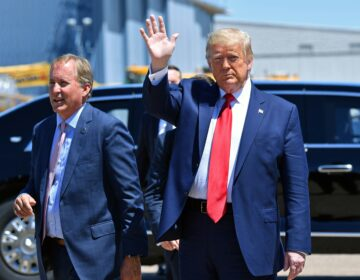 Texas Attorney General Ken Paxton, seen here alongside President Trump in Dallas in June, sued four states that Biden carried in the general election, claiming their changes to election procedures during the pandemic violated federal law. (NICHOLAS KAMM/AFP via Getty Images)