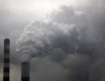 Water vapor rises from a coal powered power plant stack