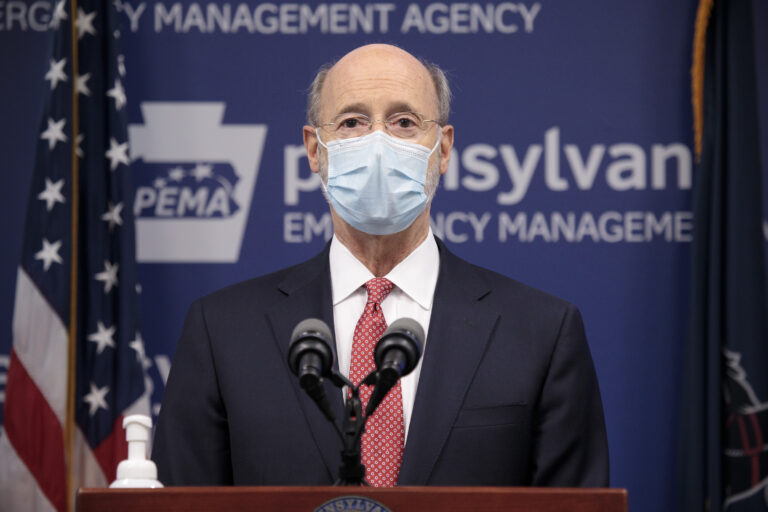 Pennsylvania Gov. Tom Wolf addresses the media while wearing a face mask