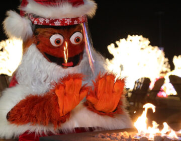Gritty dressed as Santa Claus wearing a face shield