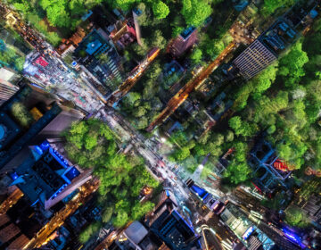 An aerial rending of Times Square, imagined in the possible future with trees taking over the urban space. That speculative future is part of the sound art piece Times3. (Courtesy of Prototype opera festival)