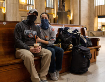 Gloriana Berry (right) and Kent Berry sit at 30th Street Station