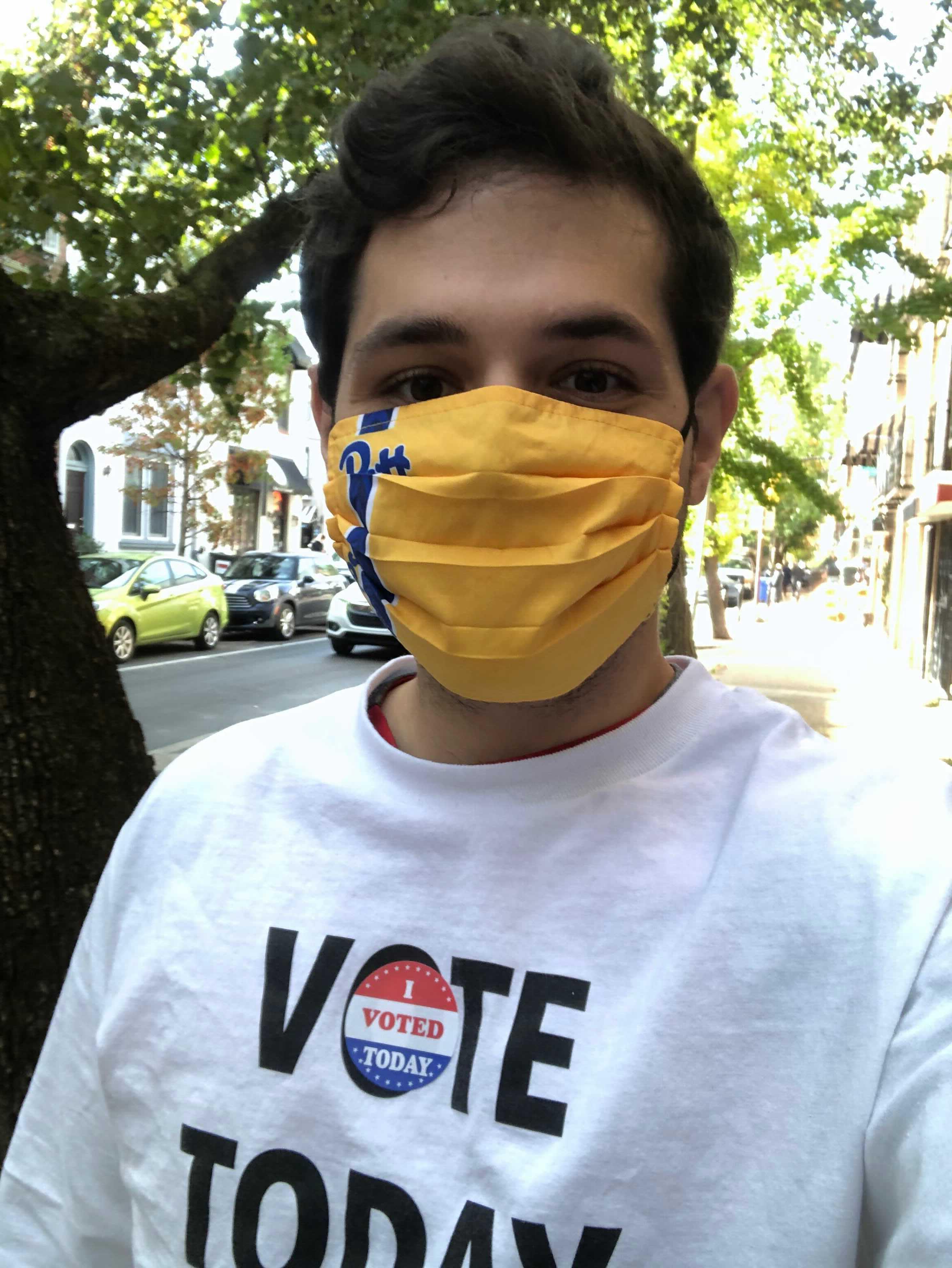Ian Snyder wears a face mask outside