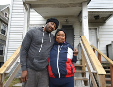 Husband and wife Darnell Williams and Patrice Mosley in front of their Millville home; Williams was recently released from the Cumberland County jail. (April Saul for WHYY)