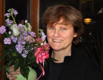 Dr. Katalin Karikó is pictured holding a vase of flowers